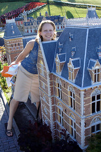 Emily is almost as tall as the building at Madurodam.  This is a city with detailed miniatures of major landmarks in Holland.  It also makes mortals look like GIANTS - Den Haag, Netherlands ... June 17, 2006 ... Photo by Rob Page III