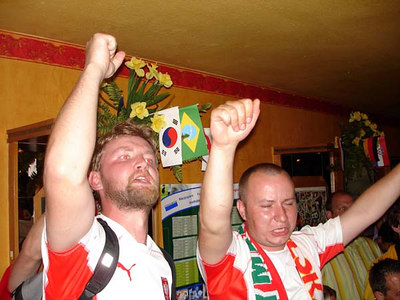 Polish fans cheering the Germany-Poland World Cup game - Dortmund, Germany ... June 14, 2006 ... Photo by Rob Page III