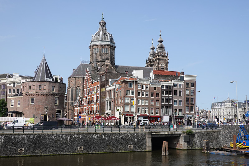 Historic Amsterdam from the canals. Left side round building commemorates Henry Hudson discovering the New York Harbor in 1609.