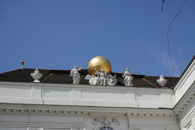 Golden balls atop the Hofburg Palace in Vienna, Austria. The House of Hofburg, alternatively called the House of Austria, was one of the most influential and distinguished royal houses of Europe. The throne of the Holy Roman Empire was continuously occupied by the Habsburgs from 1438 until their extinction in the male line in 1740.