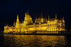 Hungarian Parliament Building lit at night from the Viking Lif.  Budapest, Hungary.