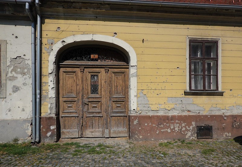 If doors could talk, the tales these could tell. Vukovar, Croatia.