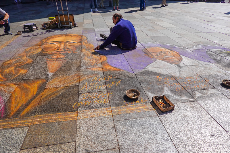 Street artist working outside the Cologne Cathedral.