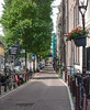 The streets of Amsterdam adjacent the canals.