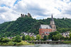 Oberwesel's Our Lady Church with Burghotel Auf Schönburg Oberwesel (Kaub) Castle Hotel on the middle Rhine on the mountain top.