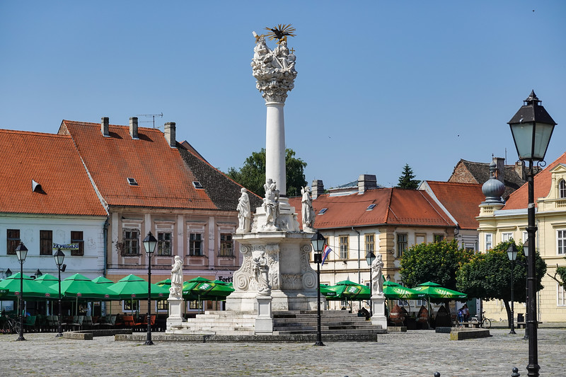 The ornate Holy Trinity Monument in Holy Trinity Square was erected almost 300 years ago after the Great Plague of 1738, the pillar is  dedicated to the thousands who  lost their lives during that year. Osijek, Croatia.