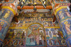 Art and religious murals decorate the walls Inside the Snagov Monastery, Romania.