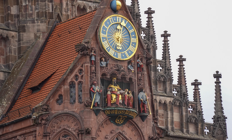 The working clock atop the Church of Our Lady, Nuremberg, Germany. Note how the figures have changed with the noon hour chimes.