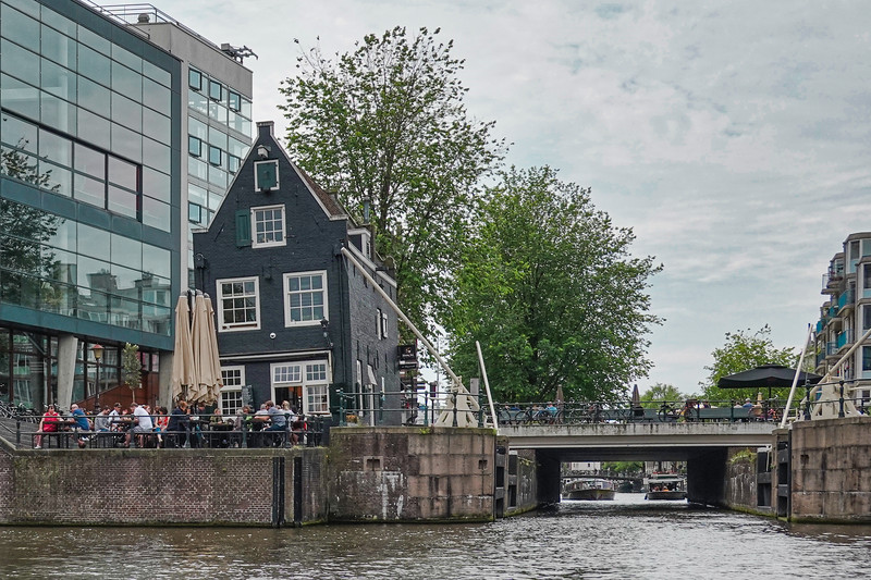 One of the oldest homes in Amsterdam (1700's) adjacent the canals. It has been converted to a tavern and eatery in modern times.