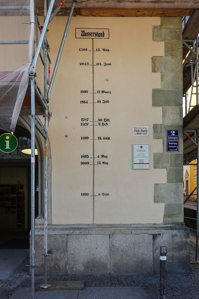Dated flood level markers on a building being renovated in Passau, Germany.