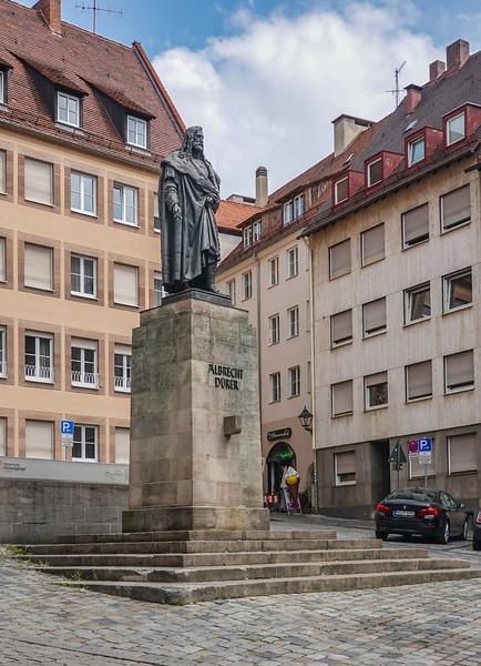 Statue honoring artist Albrecht Durer in a Old Town Nuremberg public square.