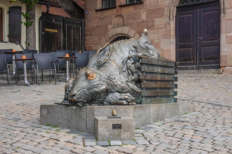 Albrecht Dürer's Nürnberg rabbit in Old Town with Jurgen Goertz'z small Der Hase in front.  Nuremberg, Germany.