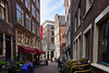 The leaning buildings of Amsterdam comes from many decades of uneven settling on their post supports.