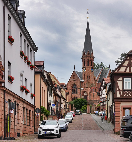 The Evangelische Johanniskirche Church at the end of the street in Miltenberg, Germany.