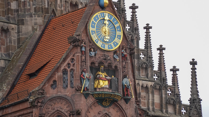 The working clock atop the Church of Our Lady, Nuremberg, Germany. Note the three figures.