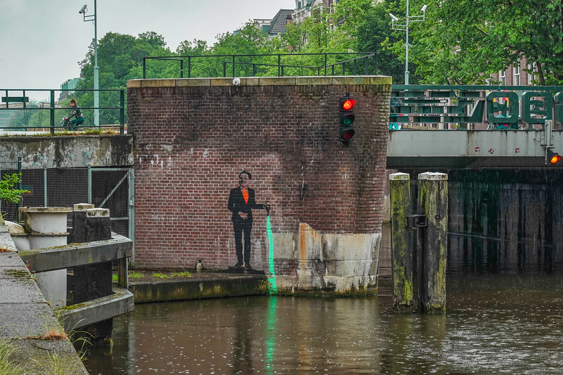 Canal art in Amsterdam on a rainy day.