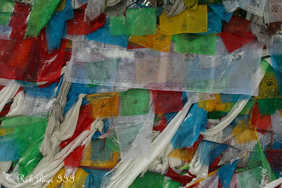 Prayer flags at a pass on the way from Tingri to Nepal - Tibet, China ... May 27, 2014 ... Photo by Rob Page III