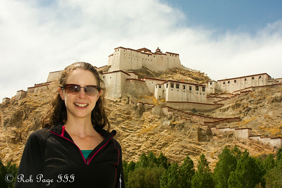 Emily in front of the Gyantse Fortress - Gyantse, Tibet, China ... May 23, 2014 ... Photo by Rob Page III