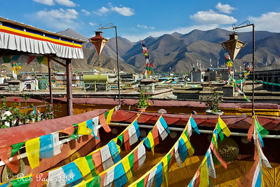 Tibetan prayer flags with the mountains rising in the background - Lhasa, Tibet, China ... May 20, 2014 ... Photo by Rob Page III