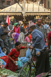 A produce vendor at the Asan Tole with the Annapurna Temple in the background - Kathmandu, Nepal ... May 28, 2014 ... Photo by Emily Page