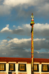 A prayer flag pole in front of the Jokhang Temple - Lhasa, Tibet, China ... May 20, 2014 ... Photo by Rob Page III
