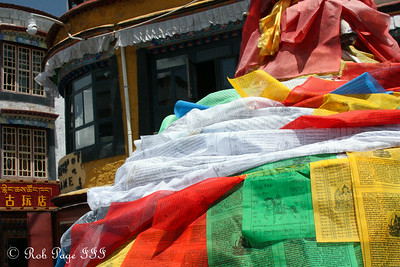 Prayer flags at the base of a prayer pole along the Barkhor kora - Lhasa, Tibet, China ... May 20, 2014 ... Photo by Rob Page III