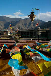 Prayer flags with the mountains rising in the background - Lhasa, Tibet, China ... May 20, 2014 ... Photo by Rob Page III