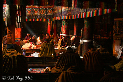 Sunlight streams in as monks perform morning prayers at the Shalu Monastery - Shigatse, Tibet, China ... May 24, 2014 ... Photo by Rob Page III