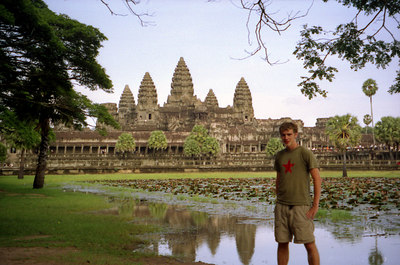 Myself in front of Angkor Wat.  This is probably the most impressive of the temples in the Angkor Wat complex at Siem Riep.  It is found on the Cambodian flag.  This temple was never left to the jungle and is an immense complex built at the beginning of the 12th century for Suryavarman in honour of Vishnu. ... August 14, 2004 ... Copyright