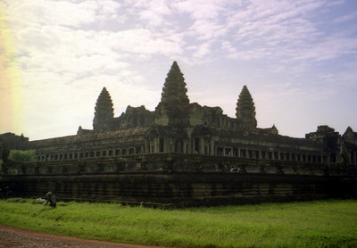 Angkor Wat from the southeast side.  A child was harvesting grass while wearing an American basketball jersey. ... August 14, 2004 ... Copyright Robert Page III