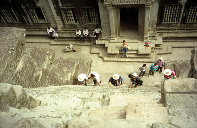 Tourists climbing up the steep steep stairs of Angkor Wat. ... August 14, 2004 ... Copyright Robert Page III