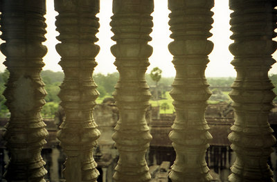 Looking out from the top of Angkor Wat through the stone bars that were over the windows. ... August 14, 2004 ... Copyright Robert Page III