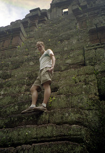 Myself climbing up the really steep steps of Phimeanakas.  According to legend the top of Phimeanakas was gold and the King had to sleep with the spirit that lived here to preserve the Khmer lineage. ... August 15, 2004 ... Copyright Robert Page III