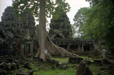 Myself in front of Banteay Kdei.  This tree really impressed me. ... August 15, 2004 ... Copyright Robert Page III