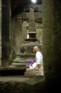 A buddhist monk relaxing within the labyrinth of Preah Khan. Sometimes it would be cool to live the life of a monk and not worry about everythign in life.  ... August 15, 2004 ... Copyright Robert Page III