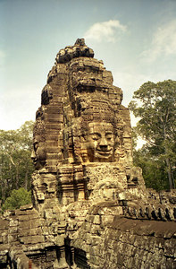 The face of Avalokiteshvara at one of the corners of the Bayon. ... August 14, 2004 ... Copyright Robert Page III