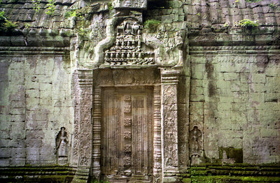 Ta Prohm.  A stone doorway adorned with Asparas. ... August 15, 2004 ... Copyright Robert Page III