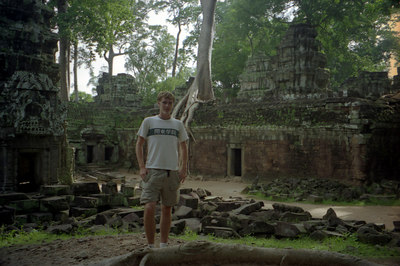 Myself at Ta Prohm.  Archeaologists have left this temples like it was when the European explorers discovered Angkor Wat.  The trees grow through and out of the ruins. ... August 15, 2004 ... Copyright Robert Page III