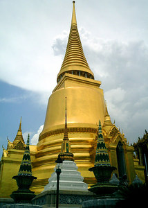 Phra Si Ratana Chedi (Golden Chedi) inside the Wat Phra Kaew Complex. Housed within the Chedi is a breastbone of the Emerald Buddha. ... August 17, 2004 ... Copyright Robert Page III
