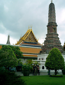 This is one of the eight prangs along the eastern edge of the Emerald Buddha complex.  Each one is decorated in Chinese porcelain and simbolizes one of the eight pillars of Buddhism. ... August 17, 2004 ... Copyright Robert Page III