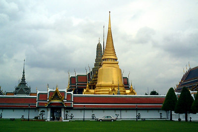 The Golden Chedi rises out of the Wat Phra Kaew Temple (The Temple of the Emerald Buddha).  It is located within the Grand Palace Complex.  It is probably the most religious location in Thailand.  This is the view from the outside. .... August 17, 2004 ... Copyright Robert Page III