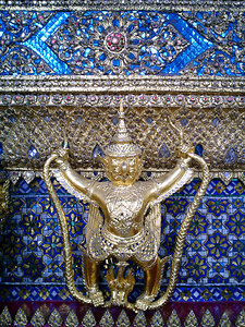 A decoration on the Orination Hall housing the Emerald Buddha. ... August 17, 2004 ... Copyright Robert Page III