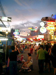 Khao San road at the beginning of a Friday night.  This is the main area for backpackers and travelers on a budget in Bangkok.  Along the roads are many stalls and internet cafes. ... August 20, 2004 ... Copyright Robert Page III