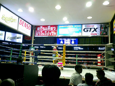 Thai Kickboxing in Bangkok.  The fighters going at it in the ring. ... August 17, 2004 .... Copyright Robert Page III