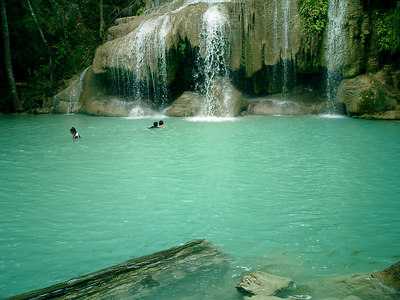 Swimming at the second tier of the Erawan Falls. ... August 19, 2004 ... Copyright Robert Page III