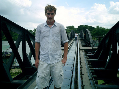 Myself on the bridge over the River Kwai in Kanchanaburi near Bangkok Thailand.  This bridge was built by POWs captured by the Japanese during WWII and the train line leads to Burma.  Also known as the Death Railroad. ... August 18, 2004 ... Copyright Robert Page III