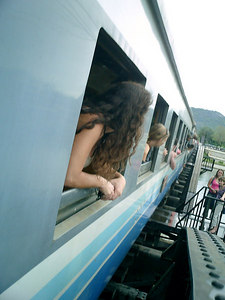 Riding a train over the River Kwai in Kanchanaburi near Bangkok, Thailand.  This is the bridge constructed by the Japanese with POW labor that is infamous from WWII. ... August 19, 2004 ... Copyright Robert Page III