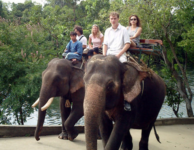 Elephant Riding near Kanchanaburi Thailand.  Rob Page riding the elephant. ... August 19, 2004 ... Copyright Robert Page III
