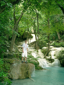 Rob Page standing in the Erawan Falls near Kanchanaburi, Thailand. ... August 19, 2004 ... Copyright Robert Page III