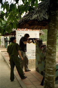 Myself shooting an AK-47.  It was really loud, but the Vietnamese guide didn't wear any ear protection. ... August 12, 2004 ... Copyright Robert Page III